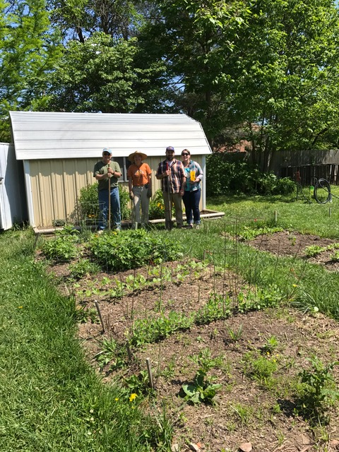 Ann St. Garden volunteers posing next to their shed