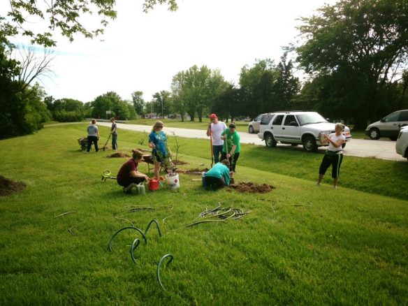 people planting at D.H. Crum garden