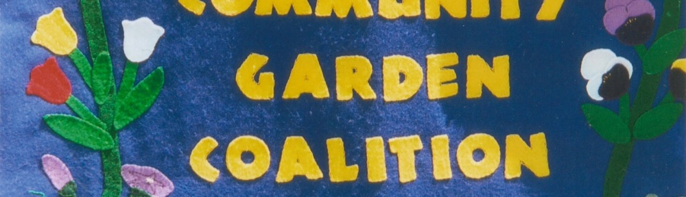 "Felt banner saying ""Community Garden Coalition Since 1983"""