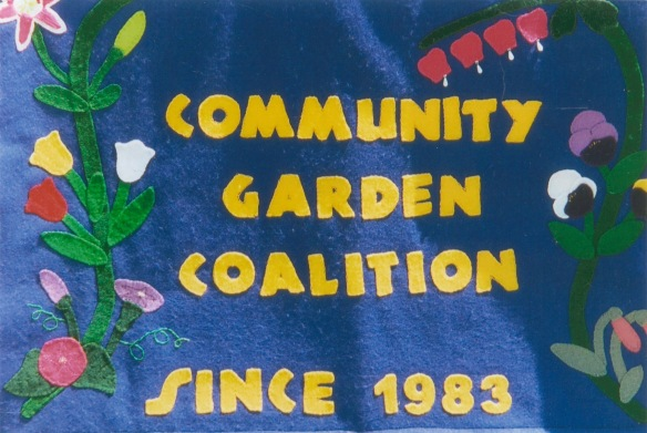"Felt banner saying ""Community Garden Coalition Since 1983"""