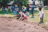 kids planting marigolds at the Circus Lyons garden