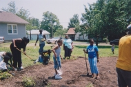 kids and adults preparing to plant
