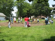 people planting in the freshly tilled Circus-Lyons garden