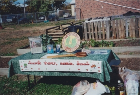 table at Claudell garden with 'Thank You Mrs Simms' banner