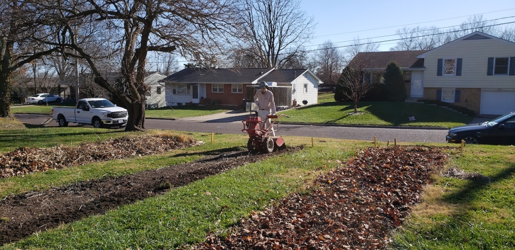 Matt using the donated tiller at the Ann St. Garden